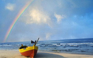 Poland, , Gdansk - near, Beach scene with boat and rainbow